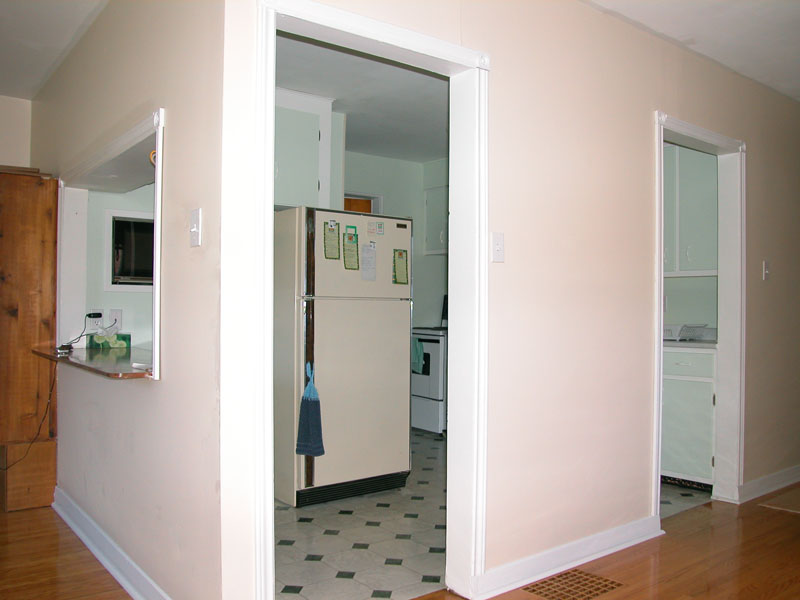 This View Of The Kitchen Is Taken By Standing In Closet Between Dining Room And Living To Show Two Entrances Into